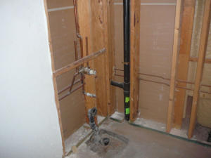 When installing a basement bathroom, the job will be simpler if the bathroom is located to an existing black vent pipe.
